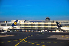 International Frankfurt Airport, the busiest airport in Germany on blue winter sky background Royalty Free Stock Photo