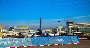 International Frankfurt Airport, the busiest airport in Germany on blue winter sky background Stock Images