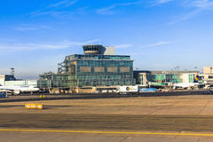 International Frankfurt Airport, the busiest airport in Germany on blue winter sky background. International Frankfurt Airport, the busiest airport in Germany royalty free stock image