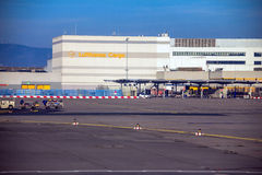 International Frankfurt Airport, the busiest airport in Germany on blue winter sky background. International Frankfurt Airport, the busiest airport in Germany royalty free stock images