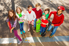 International friends stand with skateboards Stock Photography