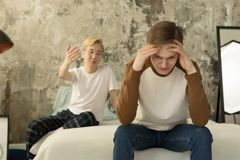 International gay couple going through relationship problems royalty free stock photography