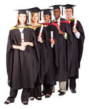 International graduates. Group of international graduates full length portrait on white Stock Photo