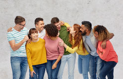 International group of happy laughing people. Diversity, race, ethnicity and people concept - international group of happy men and women laughing over gray Stock Image