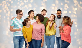 International group of happy laughing people. Diversity, race, ethnicity and people concept - international group of happy men and women laughing over holidays Stock Images
