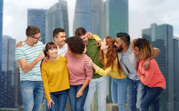International group of happy laughing people. Diversity, race, ethnicity and people concept - international group of happy men and women laughing over singapore Royalty Free Stock Photo