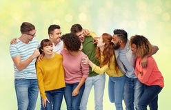 International group of happy laughing people. Diversity, race, ethnicity and people concept - international group of happy men and women laughing over summer Royalty Free Stock Photo