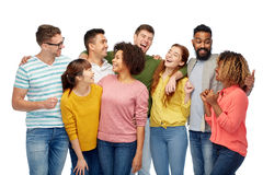 International group of happy laughing people. Diversity, race, ethnicity and people concept - international group of happy men and women laughing over white royalty free stock image