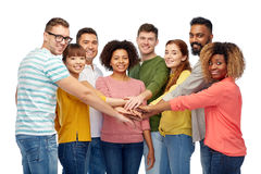 International group of happy people holding hands royalty free stock image