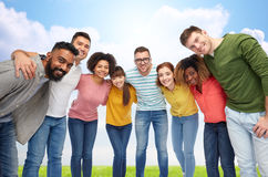 International group of happy people hugging. Diversity, race, ethnicity and people concept - international group of happy smiling men and women hugging over blue stock images