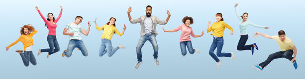 International group of happy people jumping stock image