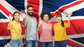 International group of happy people waving hands Stock Photos