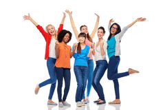 International group of happy smiling women. Diversity, race, ethnicity and people concept - international group of happy smiling different women having fun over Stock Photos