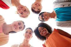 International group of happy smiling women. Diversity, race, ethnicity and people concept - international group of happy smiling different women standing in Royalty Free Stock Photos