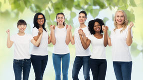 International group of happy volunteer women. Diversity, ecology and people concept - international group of happy smiling volunteer women in white blank t royalty free stock image