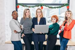 International group of happy women standing with laptop portrait royalty free stock photography