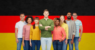 International group of people over german flag Royalty Free Stock Photos