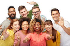 International group of people showing thumbs up. Diversity, race, ethnicity and people concept - international group of happy smiling men and women showing Stock Photos