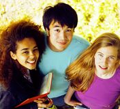 International group of students close up smiling. Portrait of international group of students close up smiling, blond girl, asian boy, young african woman Stock Photo