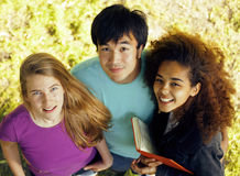 International group of students close up smiling. Portrait of international group of students close up smiling, blond girl, asian boy, young african woman Royalty Free Stock Photo