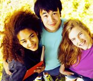 International group of students close up smiling. Portrait of international group of students close up smiling, blond girl, asian boy, young african woman Stock Photography