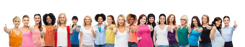 International group of women showing thumbs up. Diversity and female unity concept - international group of happy smiling different women on white background royalty free stock photos
