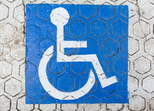 International handicapped symbol painted on the floor Royalty Free Stock Photos