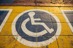 International handicapped symbol painted on walking path in the park background Stock Images