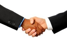 International Handshake. With white and dark skined businessman Royalty Free Stock Photo