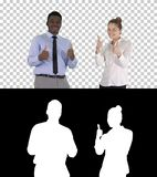 International happy smiling man and woman showing thumbs up, Alpha Channel royalty free stock photos