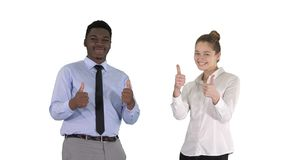 International happy smiling man and woman showing thumbs up on white background. royalty free stock photography