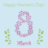 International Happy Women`s Day celebration concept with floral symbol of 8th March on blue background. Royalty Free Stock Photo