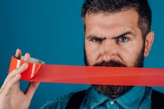 International Human Right day. censorship. Brutal bearded male. man wrapping mouth by adhesive tape. Mind control and. Propaganda. Concept freedom of speech and royalty free stock photo