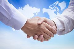 International Human Solidarity Day concept: Two businessmen shaking hands royalty free stock photos
