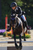International Jumping Competition Riders Stock Image
