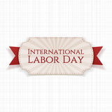 International Labor Day paper white Banner. On red festive textile Ribbon on white textile Background. Vector Illustration Royalty Free Stock Photo