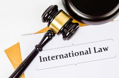 International law concept. International law documet and wooden judge on white background Stock Photography