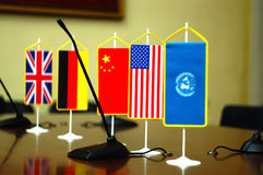 International Law and Justice. National flag of different countries in conference room, concept of international Law and Justice, focus on the United States flag Royalty Free Stock Photo