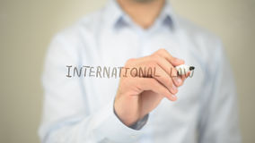 International Law, man writing on transparent screen. High quality Stock Photo