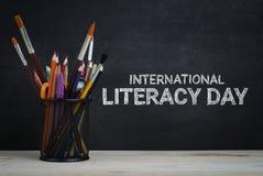 Free International Literacy Day. School Stationary On Blackboard Stock Photo - 124074910