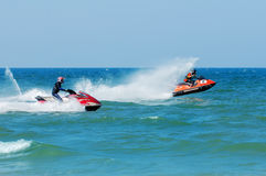 International and local PWC riders in racing actions. TERENGGANU, MALAYSIA - JULY 22-25,  2009: International and local riders participate on Jet Ski racing at Royalty Free Stock Image