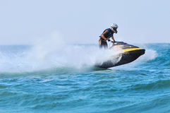 International and local PWC riders in racing actions. TERENGGANU, MALAYSIA - JULY 22-25,  2009: International and local riders participate on Jet Ski racing at Royalty Free Stock Images