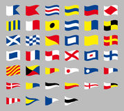International maritime signal nautical waving flags, isolated on gray background Stock Photography