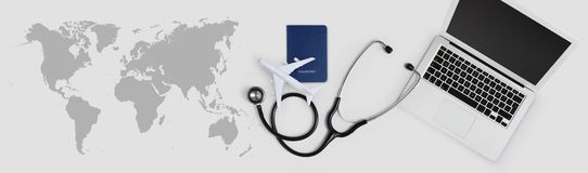 International medical travel insurance concept, stethoscope, passport, laptop computer and airplane on desk office banner with. Global map stock image