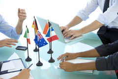 International Meeting with flags on table Royalty Free Stock Photography
