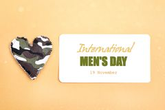 International men`s day background with military heart. International men`s day background with military heart on yellow backdrop stock images