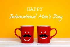International men`s day background with two red coffee mugs with royalty free stock image