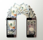 International mobile money transfer, Dollar to Japanese yen Royalty Free Stock Photo