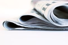 International newspapers. Close up detail of international newspapers on white background stock photography