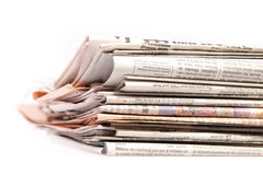 International newspapers on white. Stock Photos
